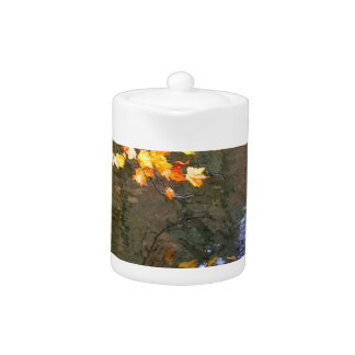 Autumn leaves on the pond teapot