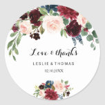 """Autumn Rustic Burgundy Love & Thanks Wedding Classic Round Sticker<br><div class=""""desc"""">This autumn rustic burgundy love & thanks wedding classic round sticker is perfect for a simple wedding. The design features burgundy,  red,  navy,  blue and blush radiant and graceful hand-painted flowers,  inspiring natural beauty.</div>"""