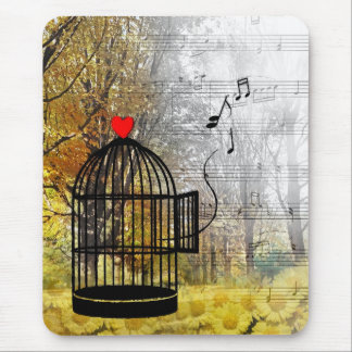 Autumn song with bird cage and he mouse pad