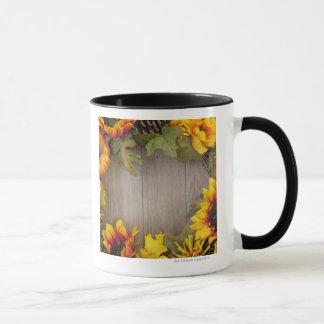 Autumn wreath on wood background mug