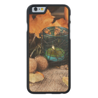 Autumnal composition with candle and leaves carved maple iPhone 6 slim case