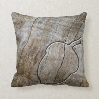 Autumnal themed acorn engraved in wood throw pillow