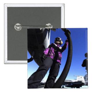 Aviation Boatswain's Mate Airman fuels an aircr Button