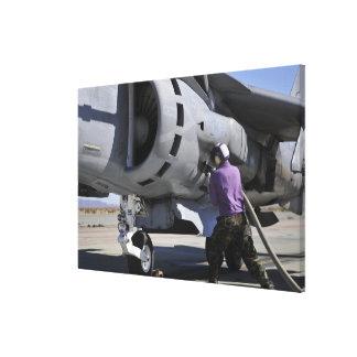 Aviation fuel technician attaches a fuel line stretched canvas prints