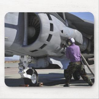 Aviation fuel technician attaches a fuel line mousepads