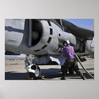 Aviation fuel technician attaches a fuel line poster