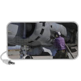 Aviation fuel technician attaches a fuel line speaker
