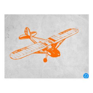 Avión anaranjado tarjetas postales