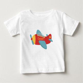 Avión colorido y adorable del dibujo animado playeras