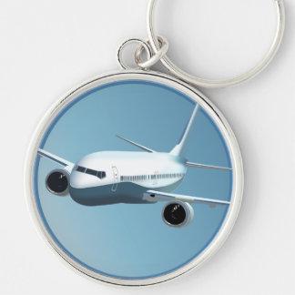 Avión de pasajeros en el llavero del cielo