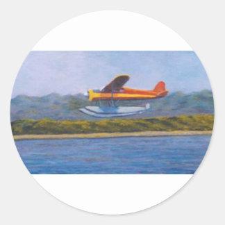 avión del flotador pegatina redonda