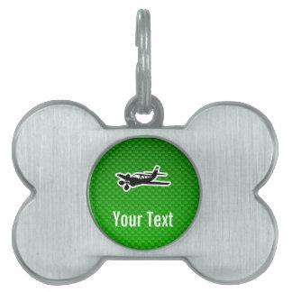 Avión verde placas de mascota