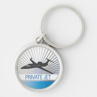 Aviones de jet privado llavero redondo plateado