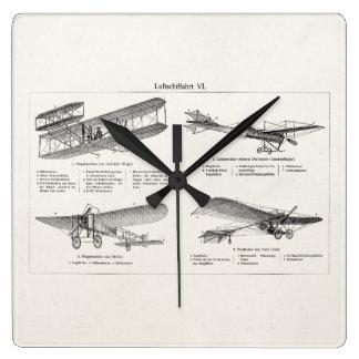 Aviones retros de la antigüedad del biplano del reloj cuadrado