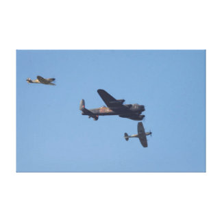 Avro Lancaster and two Spitfires Canvas Print