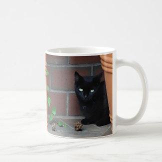 Awesome Black Cat behind Flower Pot Coffee Mug
