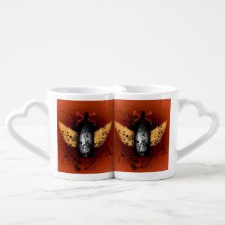 Awesome skeleton on a frame with wings coffee mug set
