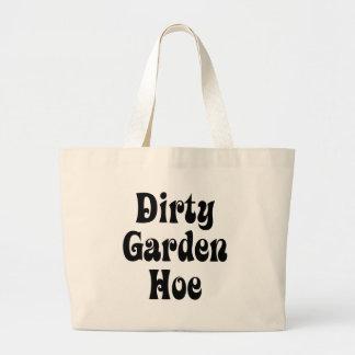 Azada sucia del jardín bolsas
