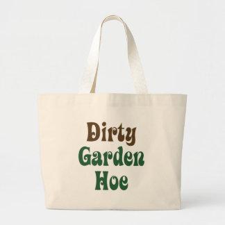 Azada sucia del jardín bolsas de mano