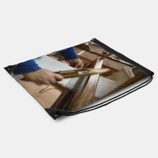 Azorean craftswoman weaving drawstring bag