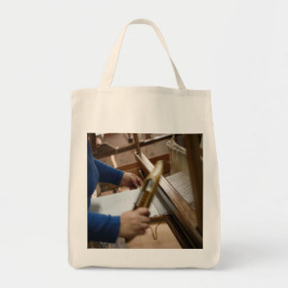 Azorean craftswoman weaving tote bag