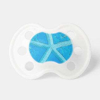 Azul coral de las estrellas de mar chupete de bebe
