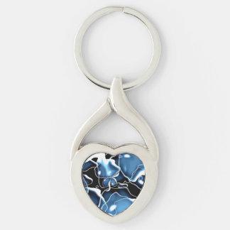Azul de forma irregular múltiple, y burbujas del llavero plateado en forma de corazón
