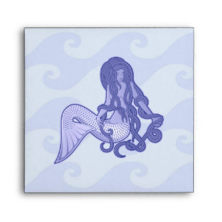 Azul de la sirena que se sienta sobre