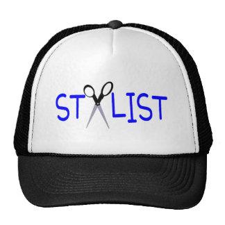 Azul del estilista con las tijeras gorras de camionero