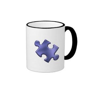 Azul del pedazo del rompecabezas del autismo taza
