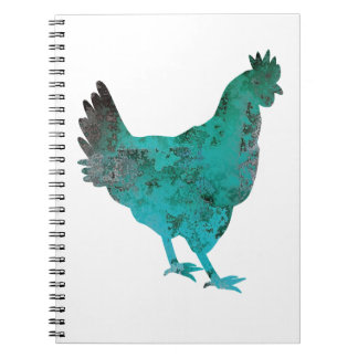Azul del trullo de la gallina del pollo en el spiral notebook