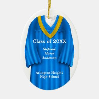 Azul del vestido del graduado y ornamento femenino adornos