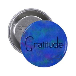 Azul en el botón azul de la gratitud del bloque pin