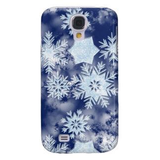 Azul helado de los copos de nieve del invierno