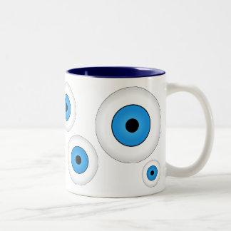 Azul loco de la taza de café de los globos del ojo