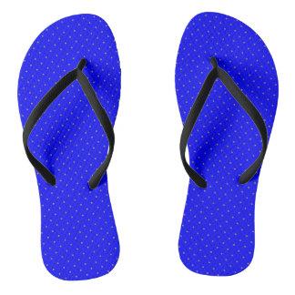 Azul real de los flips-flopes con los puntos de