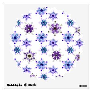 Azul y copos de nieve chispeantes púrpuras del inv