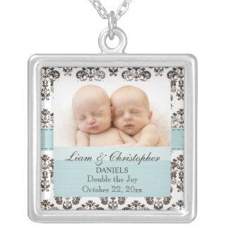 Azul y gemelos del collar de la foto del bebé del