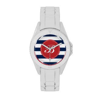 Azules marinos y monograma rojo del modelo de las  relojes de mano
