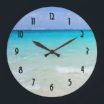 "Azure Blue Caribbean Tropical Beach Large Clock<br><div class=""desc"">A white sandy beach with gentle waves and a vivid ocean view of crystal clear turquoise waters. Bright blue  sky and soft fluffy clouds overlook this dreamy tropical caribbean vacation spot. Tranquil and secluded,  the perfect spot to relax and unwind.</div>"