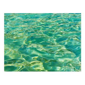 Azure water under bright noon sun postcard
