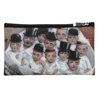 Babies in Newspaper Makeup Bags