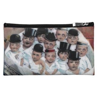 Babies in Newspaper Makeup Bag