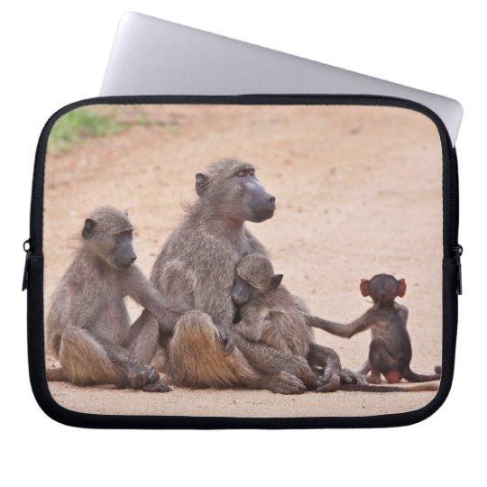 Baboon family sitting on ground laptop sleeve