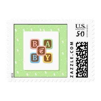 Baby Alphabet Blocks on Green Postage