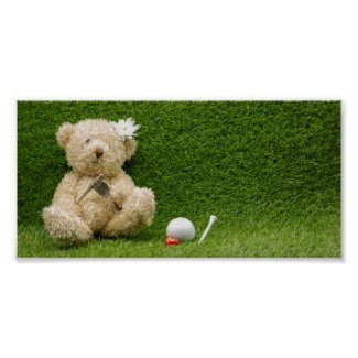 Baby bear is sitting at 19th hole with golf ball poster