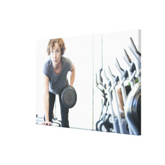 Baby boomer woman working out triceps in health canvas print