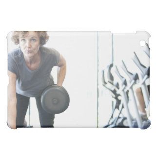 Baby boomer woman working out triceps in health iPad mini cover