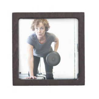 Baby boomer woman working out triceps in health jewelry box