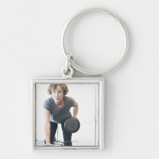 Baby boomer woman working out triceps in health keychain